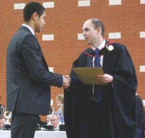 Piers receiving an award at Commem 2013